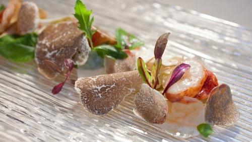 8 1/2 Otto e Mezzo BOMBANA's warm lobster salad with autumn vegetables and confit iberico ham & alba white truffles.