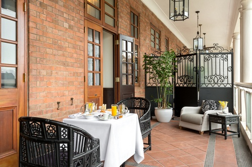 Hullett House hotel's Pui O Suite private balcony with room service breakfast.