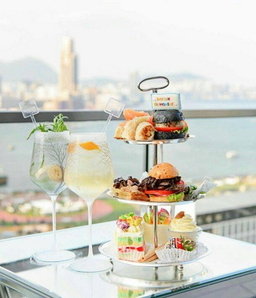 SEVVA Afternoon Tea set with views to the Hong Kong Victoria Harbour.
